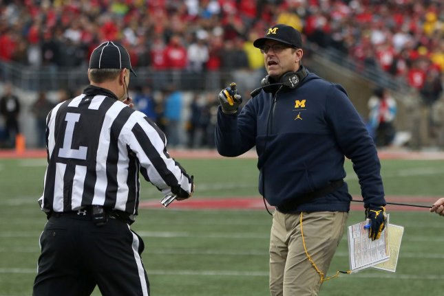Michigan Wolverines head coach Jim Harbaugh talks to the line judge during a game against Ohio State on November 24, 2018 in Columbus, Ohio. Photo by Aaron Josefczyk/UPI