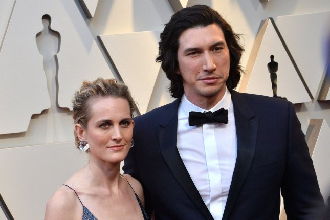 Adam Driver (R), pictured with Joanne Tucker, File Photo by Jim Ruymen/UPI