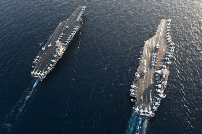 An aerial view of the Nimitz-class aircraft carriers USS John C. Stennis and USS Abraham Lincoln, which are expected to meet in the Persian Gulf in response to Iranian threats. Photo by Kenneth Abbate/U.S. Navy