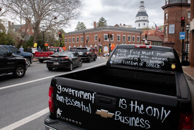 Demonstrators participate in a vehicle protest that called for Maryland businesses to reopen amid the COVID-19 pandemic, near the state capitol building in Annapolis, Md., on April 18. File Photo by Kevin Dietsch/UPI