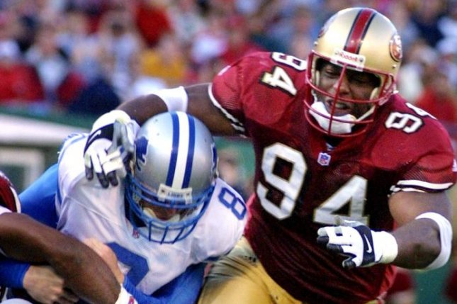San Francisco 49ers tackle Dana Stubblefield (94) moves in for a tackle against Detroit Lions QB Mike McMahon during a game in 2001. File Photo by Terry Schmitt/UPI
