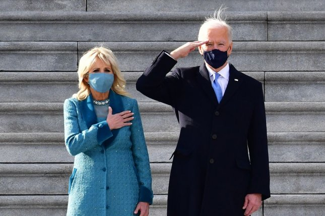 President of the United States Joe Biden salutes as wife Jill Biden puts her hand on her heart after Biden is sworn in as the 46th President of the United States Wednesday.Celebrities, including Mindy Kaling and Eva Longoria, reacted to the inauguration on social media. Photo by David Tulis/UPI