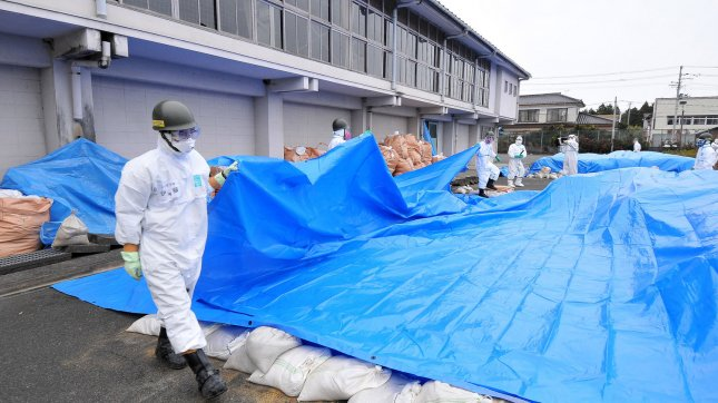 Member of Japan's Ground Self Defense Force decontaminate at the city office of Namie Machi, 8 kilometers from the Fukushima Dai-ichi nuclear power plant in Fukushima prefecture, Japan, on December 8, 2011. UPI/Keizo Mori