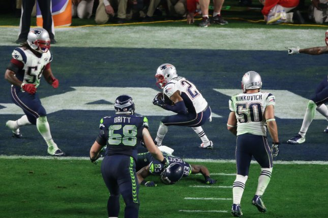 The New England Patriots host the Seattle Seahawks this Sunday night in a rematch of Super Bowl 49. Patriots cornerback Malcolm Butler (C) is pictured making the game saving interception late in the fourth quarter of Super Bowl 49 giving New England a 28-24 win. Photo by Jon SooHoo/UPI