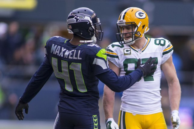 Seattle Seahawks cornerback Byrom Maxwell (41) jokes with Green Bay Packers wide receiver Jordy Nelson (87) during the NFC Championship game at CenturyLink Field in Seattle, Washington on January 18, 2015. The Seattle Seahawks beat the Green Bay Packers in overtime 28-22 for the NFC Championship Seattle. Photo by Jim Bryant/UPI
