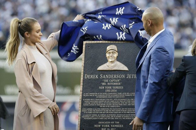 Derek Jeter unveils the Monument Park Plaque with Hannah Jeter at a ceremony retiring his number before the Houston Astros play the New York Yankees at Yankee Stadium in New York City on May 14, 2017. The New York Yankees former shortstop had his No. 2 retired and was also honored with a plaque in Monument Park. Photo by John Angelillo/UPI