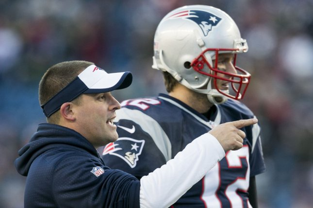 New England Patriots offensive coordinator Josh McDaniels and quarterback Tom Brady (12) go through warmups before facing the Kansas City Chiefs in the AFC Divisional Playoff game at Gillette Stadium in Foxborough, Massachusetts on January 16, 2016. File photo by Kelvin Ma/UPI
