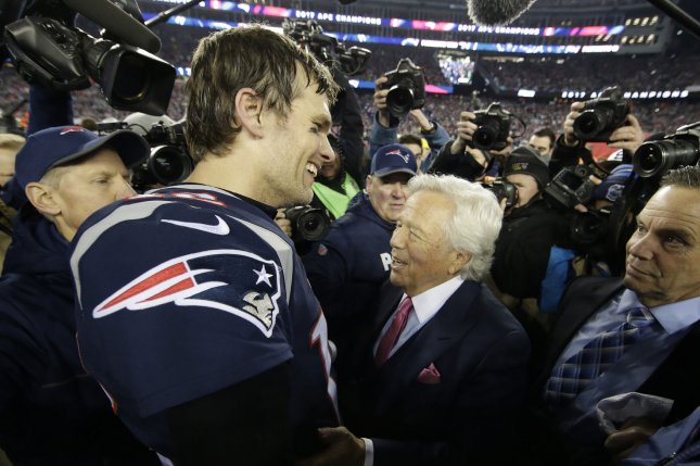 New England Patriots owner Robert Kraft (R) congratulates quarterback Tom Brady after defeating the Jacksonville Jaguars 24-20 in the AFC Championship game on January 21 at Gillette Stadium in Foxborough, Massachusetts. File photo by John Angelillo/UPI