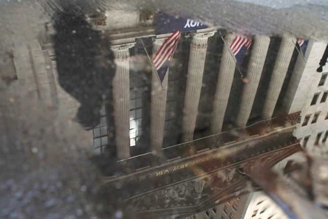 The New York Stock Exchange on Wall Street in New York City is seen Monday reflected in a puddle. Photo by John Angelillo/UPI