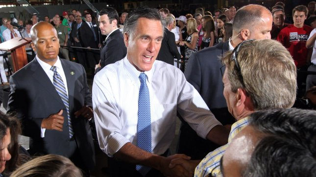 Republican Presidential candidate Mitt Romney shakes hands of supporters during a campaign stop at Production Products in St. Louis on June 7, 2012. UPI/Bill Greenblatt
