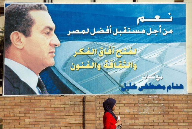 Citizen walks in front of an election campaign poster for incumbent Egyptian President Hosni Mubarak in Cairo on August 31, 2005. Caption reads: 'Yes for a better future for Egypt.' The majority of campaign posters and banners appearing throughout Cairo are placed by supporters of the incumbent President as an act of loyalty and to demonstrate their support for him during the upcoming presidential elections on September 7, 2005. (UPI Photo/Stewart Innes)