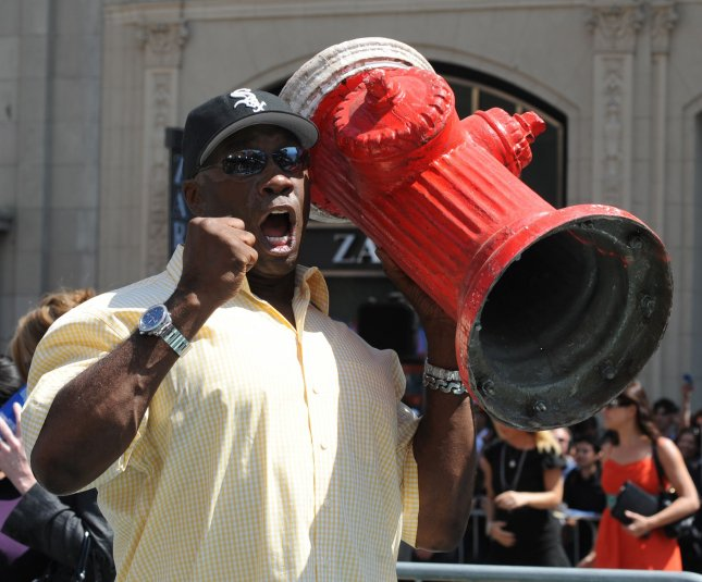 Cast member Michael Clarke Duncan picks up a fire hydrant prop as he attends the premiere of the motion picture action comedy Cats & Dogs: The Revenge of Kitty Galore, at Grauman's Chinese Theatre in the Hollywood section of Los Angeles on July 25, 2010. UPI/Jim Ruymen