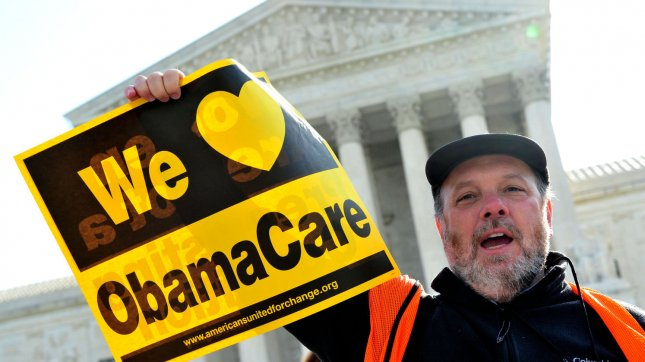 A supporter holds a sign in front of the U.S. Supreme Court as the court hears it's third day of arguments on the constitutionality of President Obama's health care bill in Washington, D.C. on March 28, 2012. UPI/Kevin Dietsch