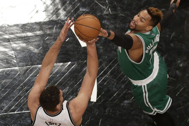 Boston Celtics' Jared Sullinger leaps to try to block a shot from Brooklyn Nets' Brook Lopez in the first half at Barclays Center in New York City on November 22, 2015. Photo by John Angelillo/UPI