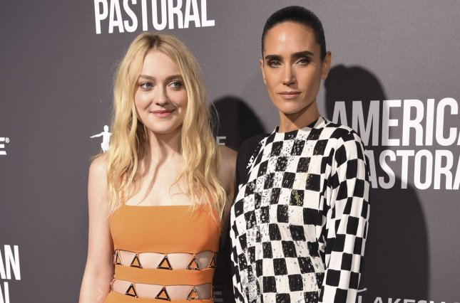 Dakota Fanning (L) and Jennifer Connelly at the Los Angeles premiere of American Pastoral on Thursday. Photo by Phil McCarten/UPI