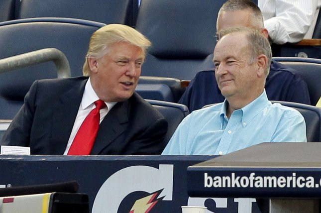 Donald Trump and Bill O'Reilly watch the New York Yankees play the Baltimore Orioles at Yankee Stadium in New York City on July 30, 2012. Photo by John Angelillo/UPI