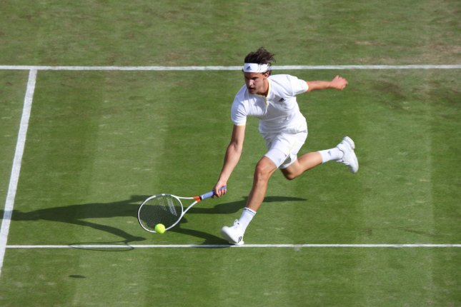 Austria's Dominic Thiem returns against Canada's Vasek Pospisil on day two of the 2017 Wimbledon championships, London on July 4, 2017. New research suggests a match's likely winner and loser can be revealed by the pitch of each player's grunts. Photo by Hugo Philpott/UPI