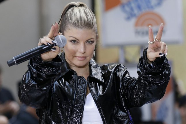 Fergie performs on Today on September 22. The singer's A Little Work music video features her son, Axl Jack. File Photo by John Angelillo/UPI