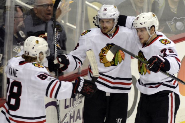 Chicago Blackhawks center Marcus Kruger (16) celebrates his goal with right wing Patrick Kane (88) and left wing Artemi Panarin (72) in the first period against the Pittsburgh Penguins at the PPG Paints Arena in Pittsburgh on March 29, 2017. File photo by Archie Carpenter/UPI
