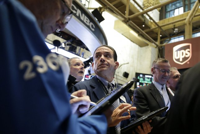 Traders work on the floor of the New York Stock Exchange Friday. A new survey by Gallup Monday said just 12 percent of Americans cite an economic issue as the nation's chief concern, a record low. Photo by John Angelillo/UPI