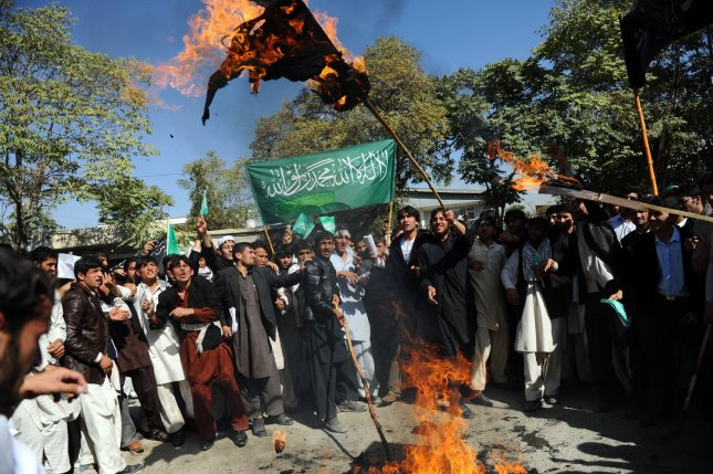 Afghan university students shout anti-U.S. slogans as they burn an effigy of President Barack Obama during a demonstration in Kabul, Oct. 25, 2009. Afghans protested over allegations that Western troops fighting the Taliban had set fire to a copy of the Koran. (UPI Photo/Hossein Fatemi)