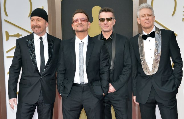 Bono and the members of U2 arrive on the red carpet at the 86th Academy Awards at Hollywood & Highland Center in the Hollywood section of Los Angeles on March 2, 2014. UPI/Kevin Dietsch