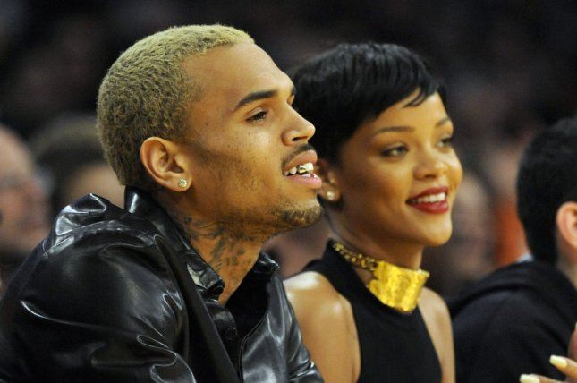 Chris Brown, seen here with ex Rihanna in 2012, said in an interview for his official documentary he felt like a [expletive] monster after a domestic violence incident left Rihanna's face battered. File Photo by Lori Shepler/UPI