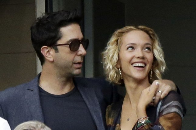David Schwimmer (L) and Zoe Buckman attend the U.S. Open Tennis Championships on September 8, 2014. The couple announced their separation Wednesday after six years of marriage. File Photo by John Angelillo/UPI