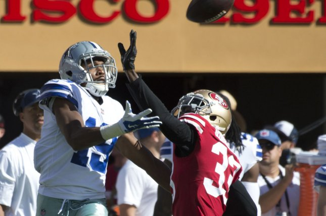 Dallas Cowboys receiver Brice Butler (19) is interfered with by former San Francisco 49ers and current New York Jets cornerback Rashard Robinson (33) while trying to catch a Dak Prescott pass in the first quarter at Levi's Stadium in Santa Clara, California on October 22, 2017. File photo by Terry Schmitt/UPI
