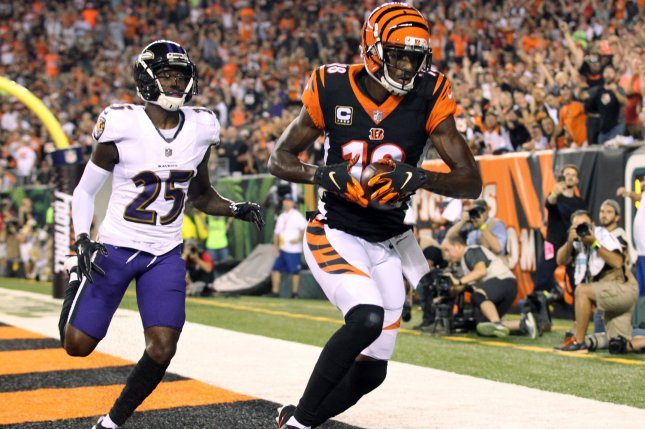 Cincinnati Bengals wide receiver A.J. Green (18) makes a touchdown catch while under pressure from the Baltimore Ravens' Tavon Young (25) during the first half of play on September 13 at Paul Brown Stadium in Cincinnati. Photo by John Sommers II/UPI