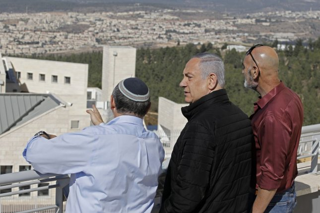 Israeli Prime Minister Benjamin Netanyahu (C) meets Tuesday with heads of Israeli settlement authorities at the Alon Shvut settlement, in the Gush Etzion block in the occupied West Bank. Pool Photo by Menahem Kahana/UPI