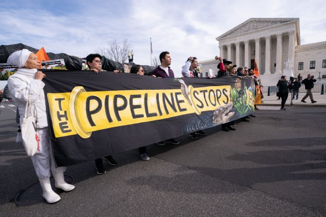 Climate activist with Friends of the Earth participate in a demonstration again the Atlantic Coast Pipeline. On Sunday, Duke Energy and Dominion Energy announced their decision to cancel the project after six years. File Photo by Kevin Dietsch/UPI