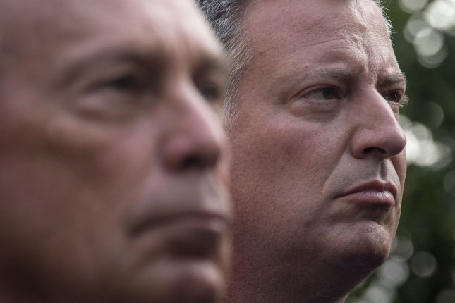 New York mayor-elect Bill de Blasio (R) stands near New York Mayor Michael Bloomberg during the 9/11 Memorial ceremonies marking the 12th anniversary of the 9/11 attacks on the World Trade Center in New York on September 11, 2013. UPI/Adrees Latif/POOL