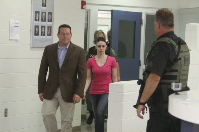 Casey Anthony (center) walks out of the the Orange County Jail with her former attorney Jose Baez (left) July 17, 2011 in Orlando, Florida. Baez has left the Anthony legal team. UPI/Red Huber/Pool