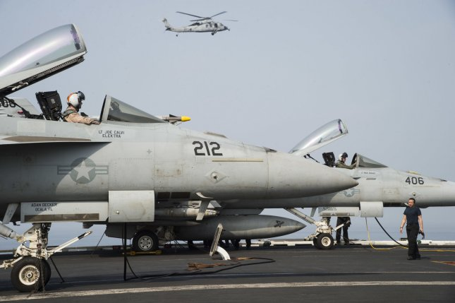 Two F/A-18E Super Hornets undergo preliminary checks on the flight deck of the aircraft carrier USS Dwight D. Eisenhower (CVN 69) on July 26, 2016, in the Arabian Sea. Ike and its Carrier Strike Group are deployed in support of Operation Inherent Resolve, maritime security operations and theater security cooperation efforts in the U.S. 5th Fleet area of operations. Photo by Theodore Quintana/U.S. Navy/UPI