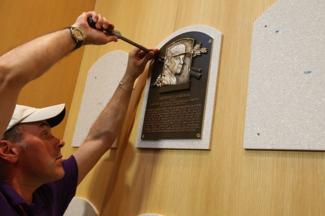 National Baseball Hall of Fame design manager Michael Fink completes the installation of the Tony La Russa placque at the National Baseball Hall of Fame iin Cooperstown, New York on July 27, 2014. La Russa, along with managers Joe Torre and Bobby Cox, Atlanta Braves Tom Glavin and Greg Maddux and Chicago White Sox Frank Thomas, were all enshrined into the hall. UPI/Bill Greenblatt