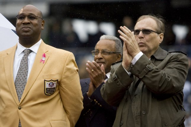 Former Seattle Seahawks defensive tackle Cortez Kennedy, left, and Seahawks owner Paul Allen, right, celebrate Kennedy's announcement to be inducted into the Pro Football Hall of Fame. Kennedy served as an adviser to Saints general manager Mickey Loomis for many years, and was also a close friend of many Saints staff members. File photo by Jim Bryant/UPI