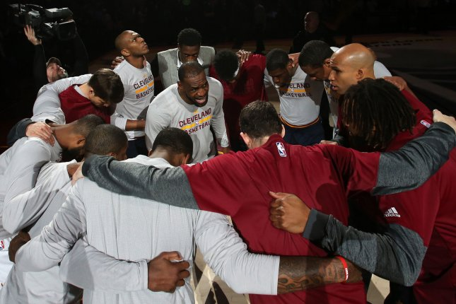 Cleveland Cavaliers' Lebron James talks to his teammates prior to the Cavs' game. File photo by Aaron Josefczyk/UPI