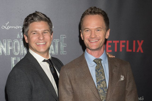 Neil Patrick Harris (R) and David Burtka attend the New York premiere of the Netflix series A Series of Unfortunate Events on January 11. The couple celebrated their third wedding anniversary Wednesday. File Photo by Bryan R. Smith/UPI