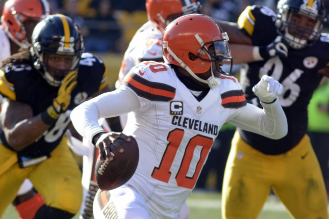 Former Cleveland Browns quarterback Robert Griffin III (10) scrambles to the right for a first down in the first quarter against the Pittsburgh Steelers on January 1, 2017 at Heinz Field in Pittsburgh. Photo by Archie Carpenter/UPI