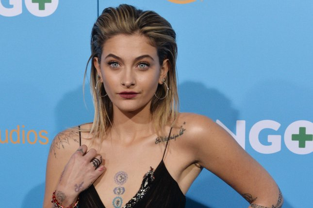 Paris Jackson on Instagram posted a photo of herself holding the hand of late grandfather Joe Jackson. File Photo by Jim Ruymen/UPI