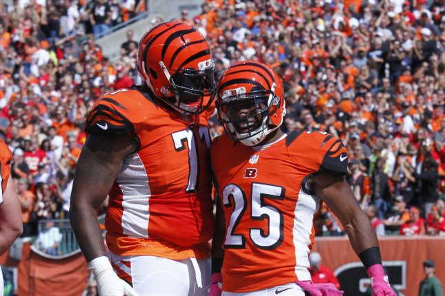Former Cincinnati Bengals offensive lineman Andre Smith (L) was waived by the Bengals in November. File Photo by John Sommers II/UPI