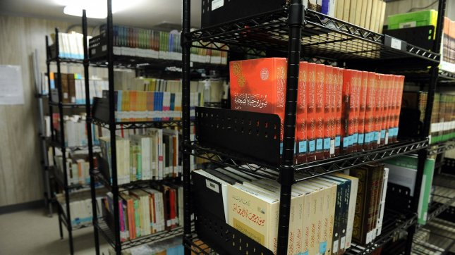 Books are seen on the shelves of the library at Camp Delta where detainees are housed at Naval Station Guantanamo Bay in Cuba on July 8, 2010. Books are available to detainees in Russian, French, English, Arabic, Farsi and other languages. UPI/Roger L. Wollenberg