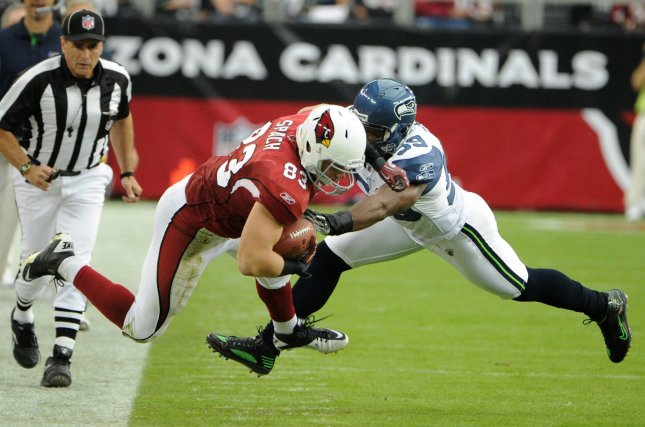 Arizona Cardinals Stephen Spach (L) is driven out of bounds after picking up a first down by Seattle Seahawks Aaron Curry (R) during the first quarter of their game against at University of Phoenix Stadium in Glendale, AZ November 14,2010. UPI/Art Foxall