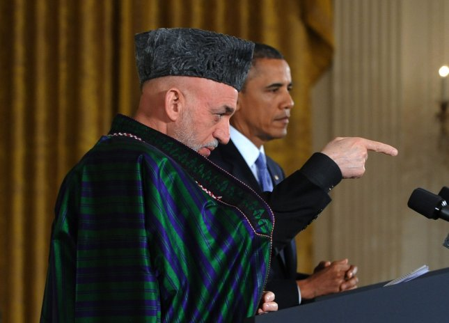 U.S. President Barack Obama listens as Afghanistan President Hamid Karzai makes a point during a joint press conference in the East Room of the White House in Washington, DC on January 11, 2013. The two leaders agreed that U.S. troops would be moving to a support role this spring. UPI/Pat Benic