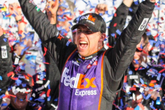 Denny Hamlin celebrates winning the closest Daytona 500 ever at Daytona International Speedway on February 21, 2016 in Daytona, Florida. Photo by Mike Gentry/UPI