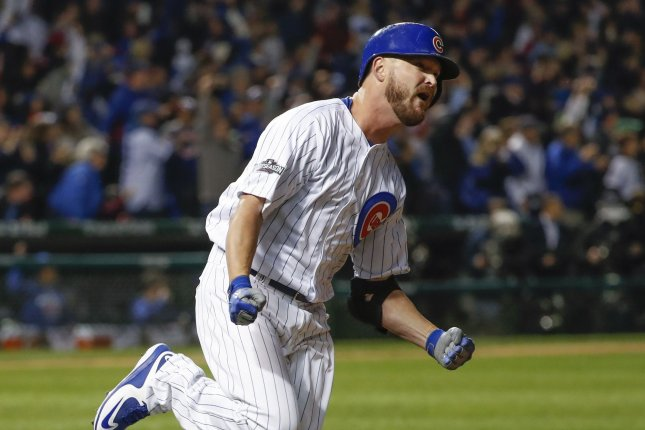 Chicago Cubs' Travis Wood runs the bases after hitting a home run against the San Francisco Giants during the fourth inning of the game 2 of the National League Division Series at Wrigley Field in Chicago on October 8, 2016. Photo by Kamil Krzaczynski/UPI