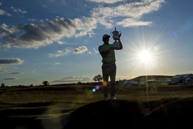 Brooks Koepka poses with the trophy after winning the 117th U.S. Open golf tournament at Erin Hills golf course on June 18, 2017, in Erin, Wisconsin. Koepka posted a final score of 16-under-par. Photo by Kevin Dietsch/UPI