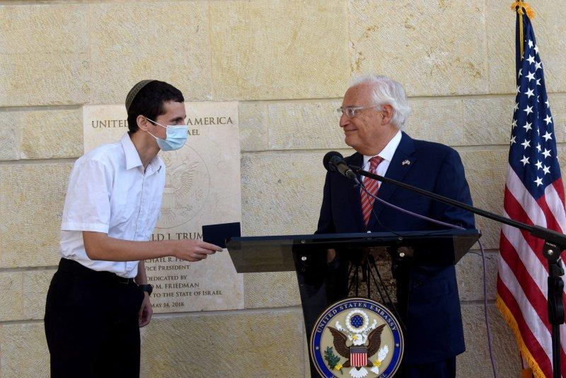 U.S. Ambassador to Israel David Friedman presents a passport presented to Menachem Zivotosky (L) at the American Embassy in Jerusalem, on Friday. Photo by Debbie Hill/UPI
