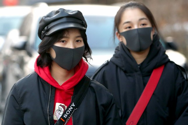 People wear protective masks in downtown Beijing on January 21, 2020, 11 days after the country reported its first known death from a novel coronavirus. File Photo by Stephen Shaver/UPI